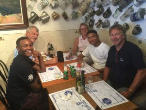 A Captains' Lunch with two student sailors